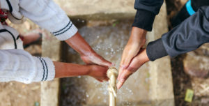 washing hands together | Water For People Jobs | Careers | Water For People
