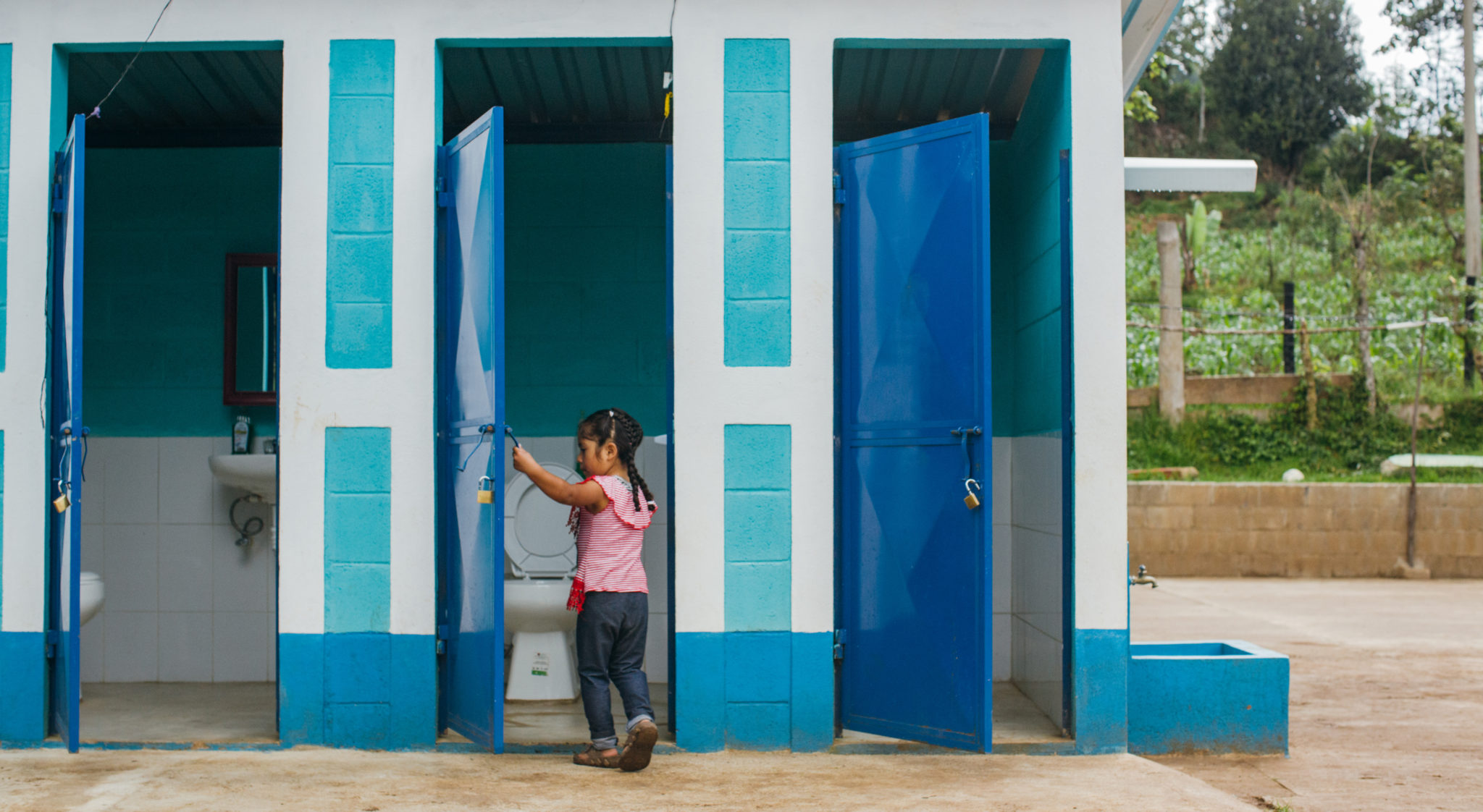 little girl going to a clean bathroom | This is What Sanitation Can Do | Water For People