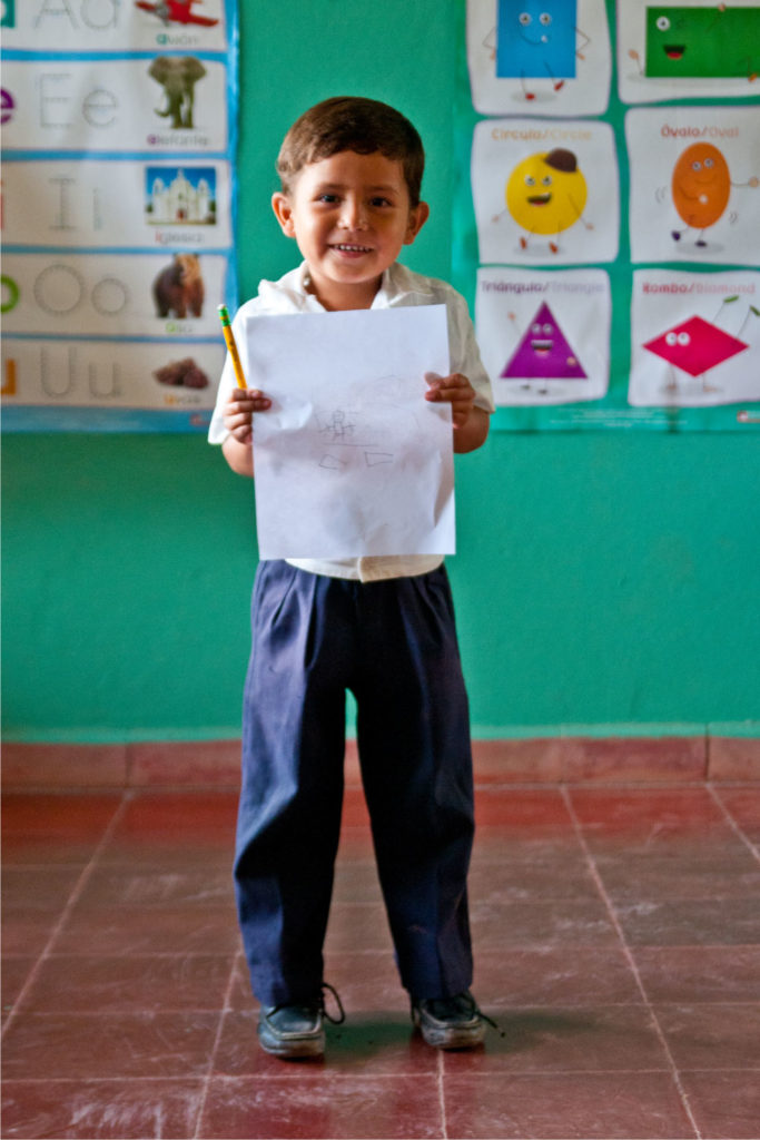 little boy holding schoolwork | Clean Water in Honduras | Where We Work | Water For People
