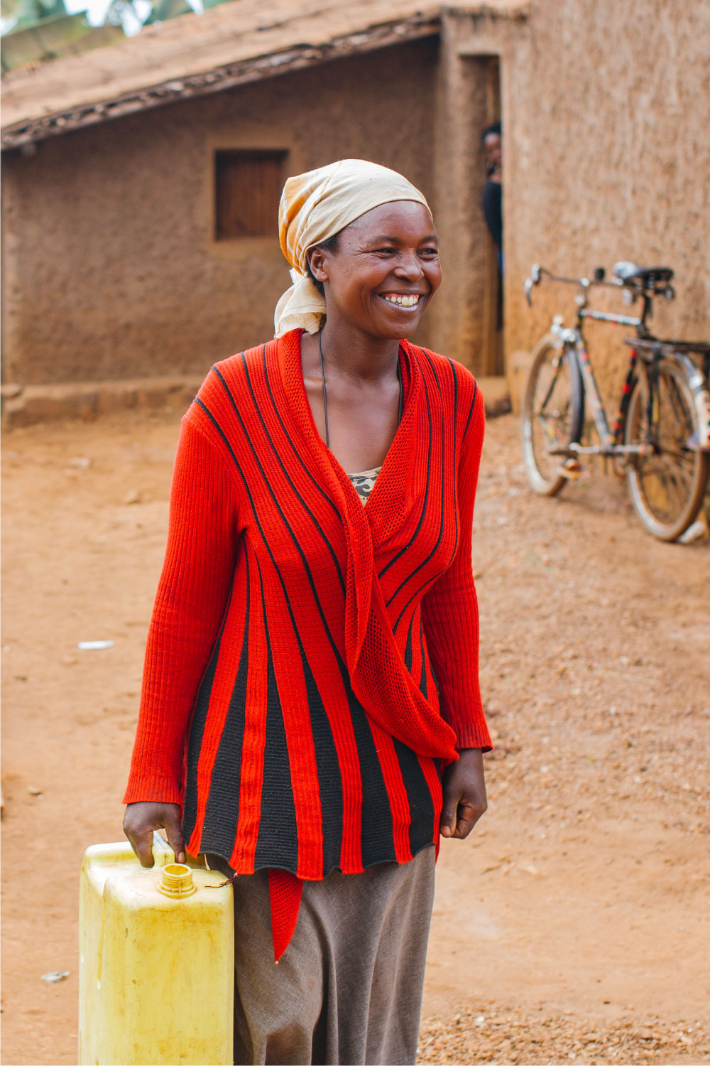 smiling woman carrying water | Best Water Organizations | Everyone Forever | Water For People