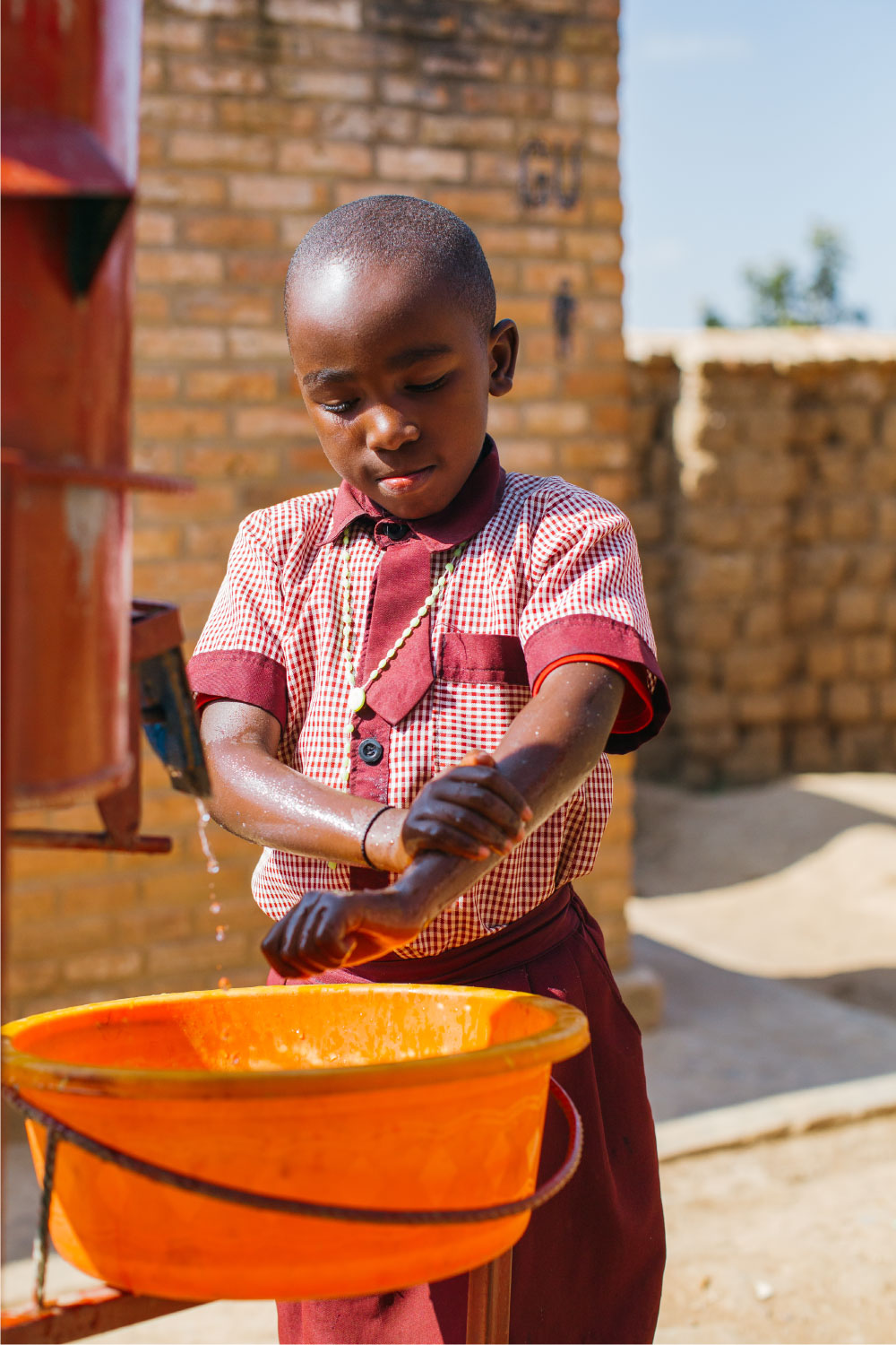 child washing his hands | Clean Water in Rwanda | Where We Work | Water For People