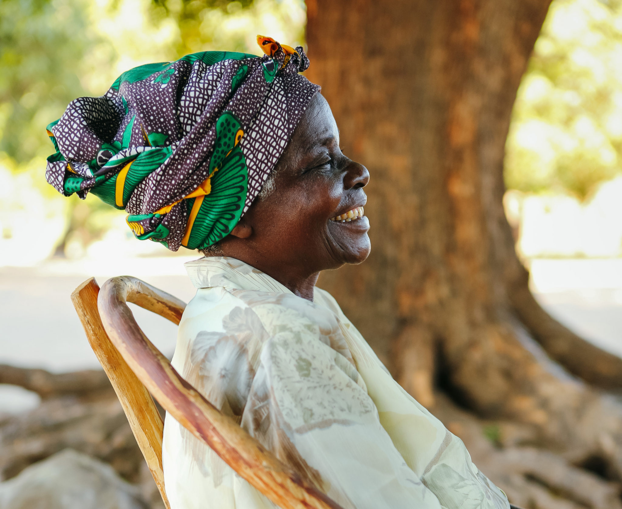 smiling older woman | Water and Sanitation Engineers | World Water Corps | Water For People