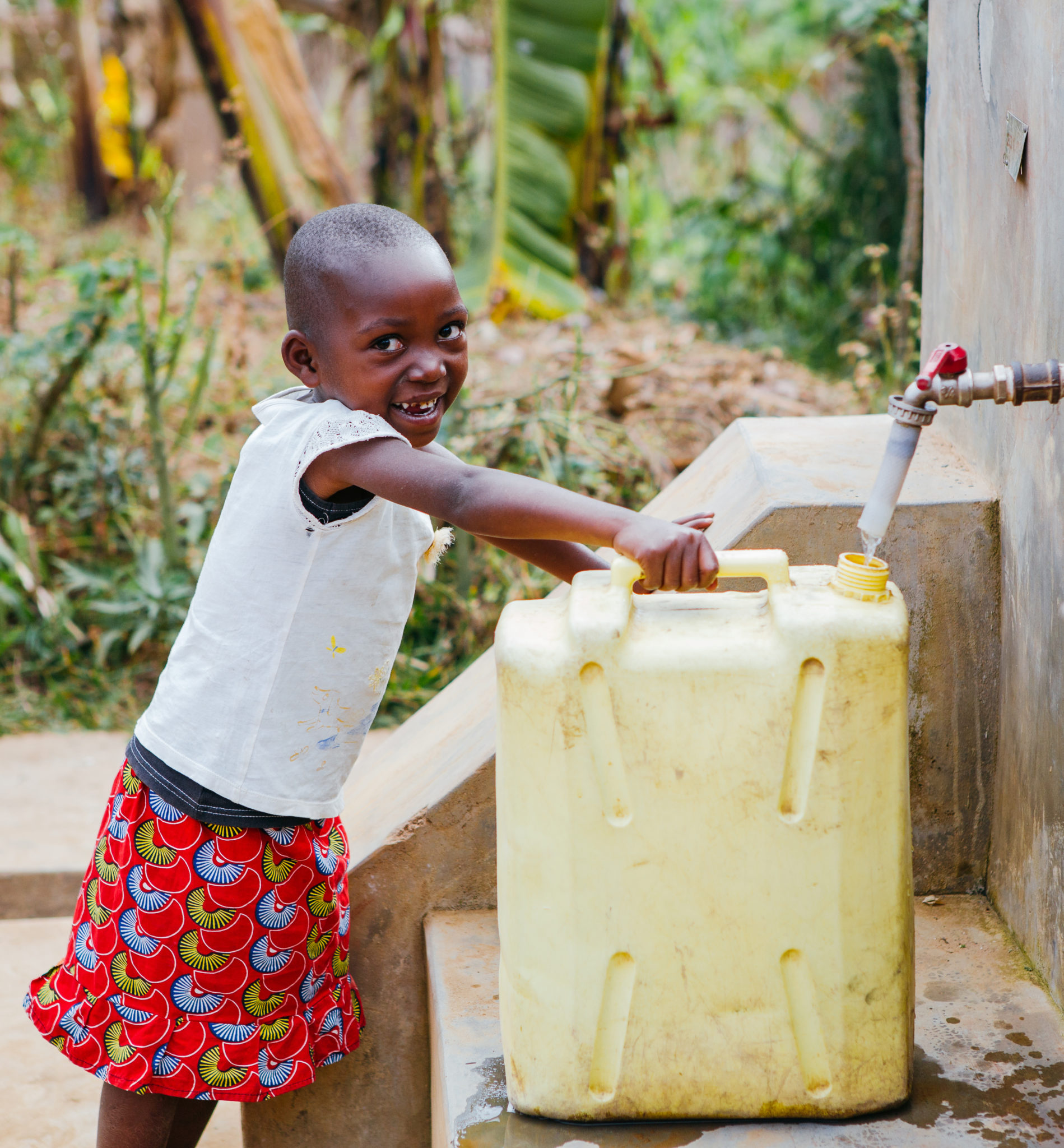 little girl filling up water jug | Fundraise for Water | Get Involved | Water For People