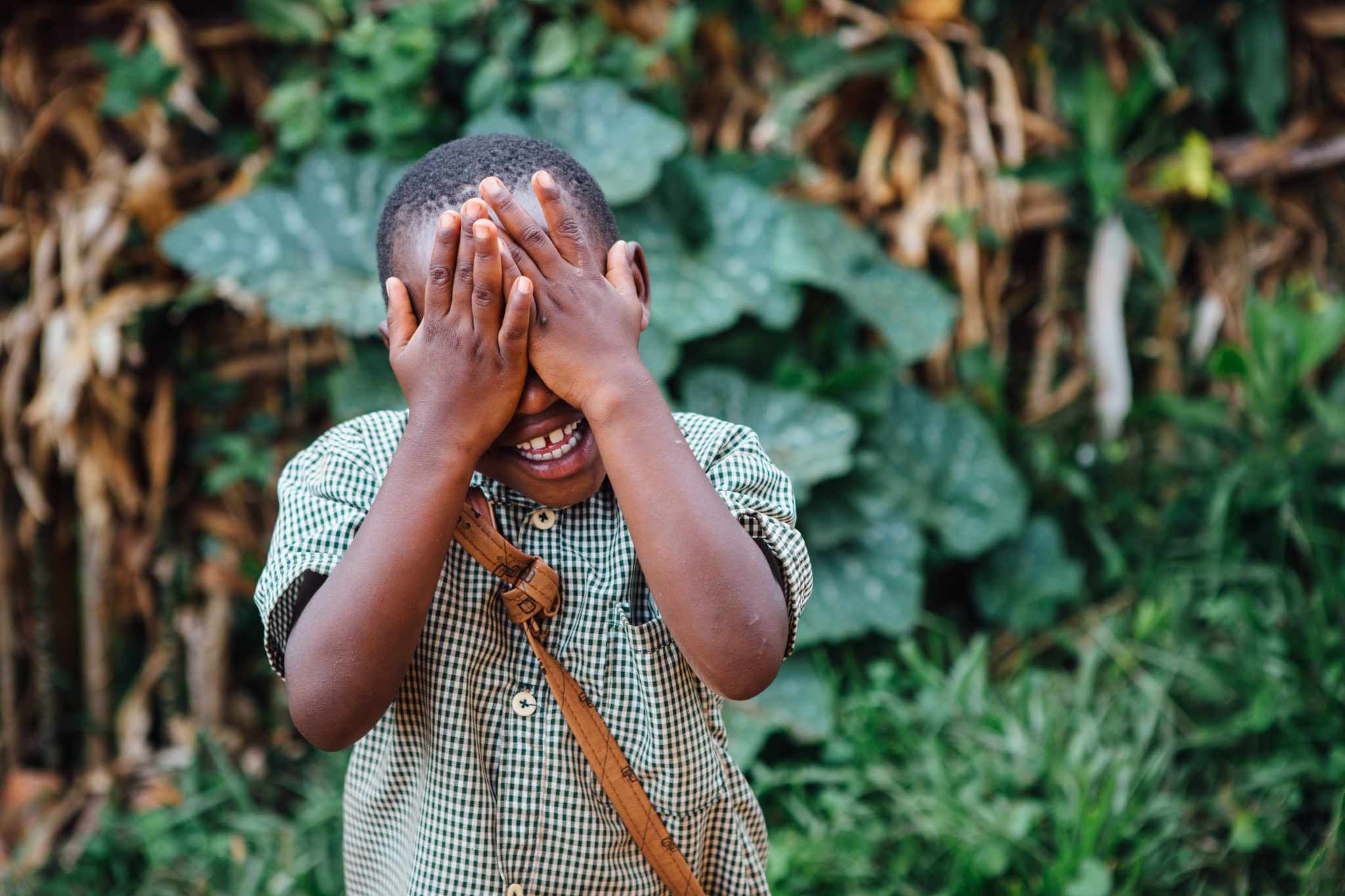 boy hiding his face | Water and Sanitation Engineers | World Water Corps | Water For People