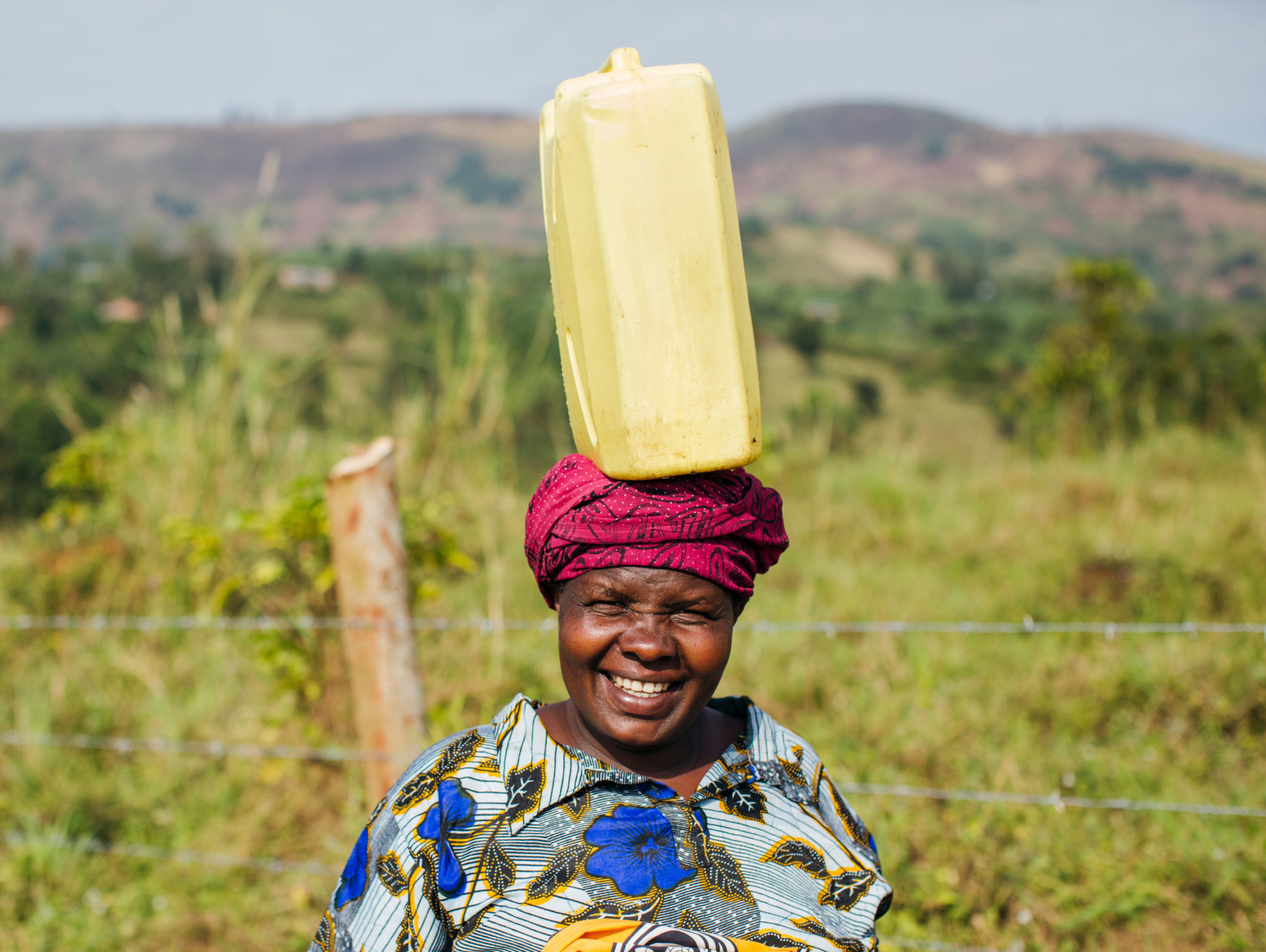 lady with water jug on head | The Strategy to Achieve SDG 6 | Water For People