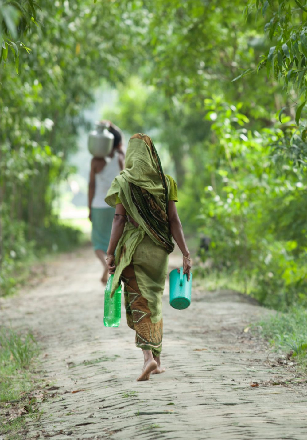 villagers carrying water | Support Clean Water | Get Involved | Clean Water in India | Where We Work | Water For People
